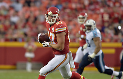 Aug 28, 2015; Kansas City, MO, USA; Kansas City Chiefs tight end Travis Kelce (87) catches a pass against the Tennessee Titans during the first half at Arrowhead Stadium. Mandatory Credit: Denny Medley-USA TODAY Sports