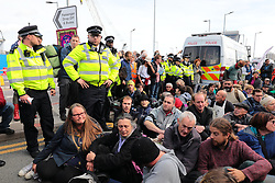 © Licensed to London News Pictures. 10/10/2019. London, UK. Extinction Rebellion protesters block the roads outside London City Airport. Protesters plan to occupy the terminal building in a 'Hong Kong-style' shutdown as part of ongoing protests calling on government departments to tackle the Climate Emergency. Photo credit: Rob Pinney/LNP
