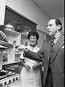 Pancake making At Ranks.   (K91)..1977..22.02.1977..02.22.1977..22nd February 1977..At Ranks experimental kitchen in Phibsborough, Dublin,Shiela Cunningham,Chief Adviser of Ranks Home Baking Service made the first pancakes of the day, today being Pancake Tuesday. While making the pancakes Ms Cunningham was surprised when an unexpected visitor dropped in. Mr Joseph Rank ,Chairman of the company ,called in to sample the first pancake of the day. He was in Dublin for the company's Annual General Meeting..Mr Joseph Rank pictured trying his hand at tossing pancakes.