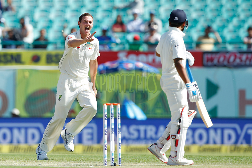Josh Hazlewood of Australia celebrates the wicket of Murali Vijay of India during day two of the fourth test match between India and Australia held at the Himachal Pradesh Cricket Association Stadium on the 26th March 2017.<br /> <br /> Photo by: Deepak Malik/ BCCI/ SPORTZPICS