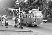 Matatus, or mini-vans, are one of the main modes of transportation in Nairobi, Kenya. They are inexpensive and colourful in driver, 'tout' and vehicle. Generally a matatu driver will leave only when the bus is full but there are many buses competing so waits in the city are reasonable.
