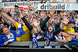 Bristol Rovers fans celebrate after their side win the match in injury time to secure 3rd place in League 2, back to back promotions and a place in Sky Bet League 1 for 2016/17 - Mandatory byline: Rogan Thomson/JMP - 08/03/2016 - FOOTBALL - Memorial Stadium - Bristol, England - Bristol Rovers v Dagenham & Redbridge - Sky Bet League 2.