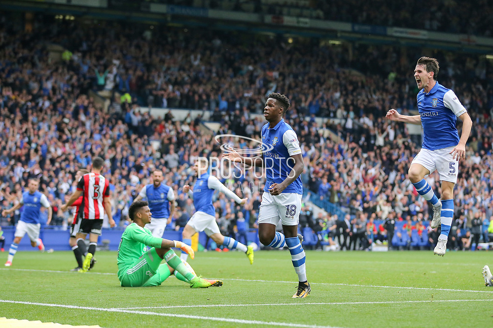 Sheffield Wednesday forward Lucas Joao (18) scores and Sheffield Wednesday midfielder Kieran Lee (5) celebrate the goal 2-2 during the EFL Sky Bet Championship match between Sheffield Wednesday and Sheffield Utd at Hillsborough, Sheffield, England on 24 September 2017. Photo by Phil Duncan.