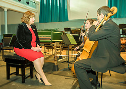 Pictured: Fiona Hyslop, Culture Secretary chats with musicians Marciana Buta (violin) and Donald Gillan (cello)<br /> Culture Secretary Fiona Hyslop announced a £650,000 grant for building improvements at the Queen's Hall, Edinburgh.<br /> <br /> © Jon Davey/ EEm