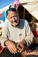 Muhammed Ramadan, age 90, sits outside his tent at the refugee camp in Atmeh, Syria. He and his family fled violence in their hometown in Idlib province and are part of the mammoth humanitarian disaster facing Syria and surrounding countries today.