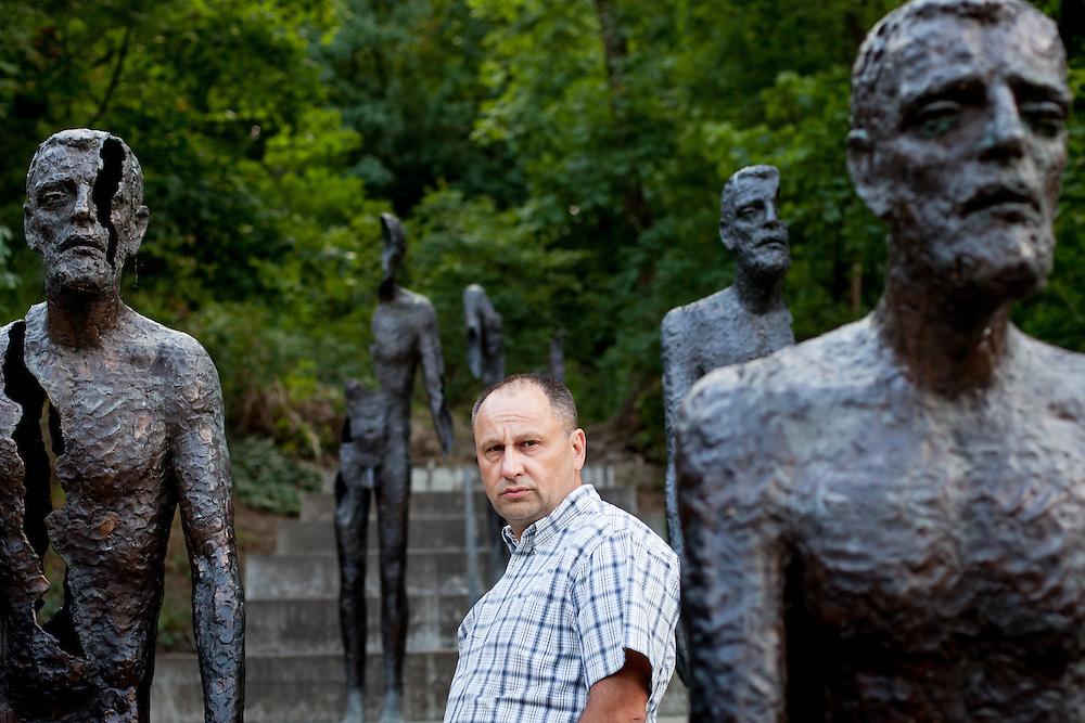 """Czech writer and historian Ludek Navara photographed at the """"Memorial to the Victims of Communism"""" created by sculptor Olbram Zoubek in Prague. ----------------------------                               Schriftsteller und Historiker Ludek Navara am """"Denkmal für die Opfer des Kommunismus"""" von Bildhauer Olbram Zoubek in Prag."""