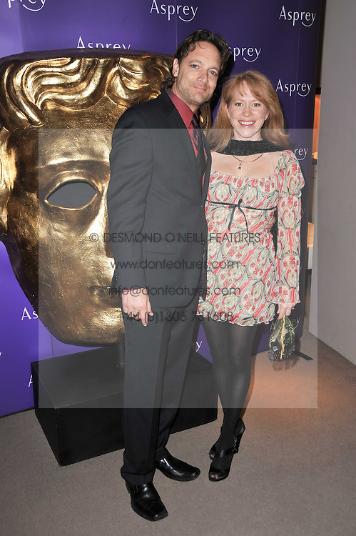Writer PAUL TAMASY and his wife CHARLENE at the BAFTA Nominees party 2011 held at Asprey, 167 New Bond Street, London on 12th February 2011.