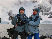 Tom and Carol Dempsey steer a Zodiac boat in the Southern Ocean at Graham Land, in Antarctica. For licensing options, please inquire.