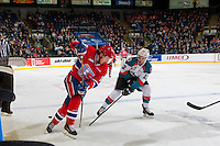 KELOWNA, CANADA - FEBRUARY 17: Erik Gardiner #12 of the Kelowna Rockets stick checks Taylor Ross #16 of the Spokane Chiefs on February 17, 2017 at Prospera Place in Kelowna, British Columbia, Canada.  (Photo by Marissa Baecker/Shoot the Breeze)  *** Local Caption ***