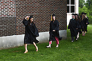 Medical assistant student Nenette McCusker shows off her gold tassel, indicating a 3.5 or higher cumulative grade point average, as she passes family and friends in the procession to the 47th commencement of River Valley Community College in Claremont, N.H. Friday, May 22, 2015. Tiffany Mooreis at right. RVCC awarded degrees to 225 students in 30 programs during the ceremony. (Valley News - James M. Patterson)<br /> Copyright &copy; Valley News. May not be reprinted or used online without permission. Send requests to permission@vnews.com.