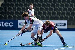 Surbiton's Zach Wallace is tackled by Chris Gregg of Wimbledon. Wimbledon v Surbiton - Men's Hockey League Final, Lee Valley Hockey & Tennis Centre, London, UK on 23 April 2017. Photo: Simon Parker