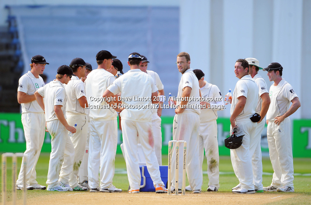 The Balck Caps gather together to celebrate a wicket. 2nd cricket test match - New Zealand Black Caps v Pakistan, day three at the Basin Reserve, Wellington, New Zealand on Monday, 17 January 2011. Photo: Dave Lintott / photosport.co.nz