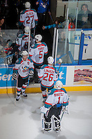 KELOWNA, CANADA -FEBRUARY 10: Madison Bowey #4 captain congratulates Cole Linaker #26 and Jackson Whistle #1 of the Kelowna Rockets on the win against the Seattle Thunderbirds as they exit the ice on February 10, 2014 at Prospera Place in Kelowna, British Columbia, Canada.   (Photo by Marissa Baecker/Getty Images)  *** Local Caption *** Madison Bowey; Cole Linaker; Jackson Whistle;