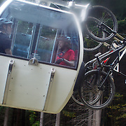 Mountain Bike racers take the Skyline Gondola to tackle the Ben Lomond Forest course high above Queenstown during the Outside Sports Super D Enduro event in Queenstown, Central Otago, at the Weekend. The 6 hour non stop team and individual races attracted 86 competitors and included Skyline Gondola access.  The Open Female category was won by Hanna Thorne from Dunedin while Kurt Lancaster from Nelson won the Open Male Category. The event was part of the inaugural Queenstown Bike Festival, taking place from 16th-25th April. The event hopes to highlight Queenstown's growing profile as one of the three leading biking centres in the world. Queenstown, Central Otago, New Zealand. 16th April 2011. Photo Tim Clayton..