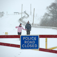 Snow in Perthshire....13.02.13<br /> Walking down the A93 at Spittal of Glenshee as heavy snow forced the closure of the snow gates blocking the route to Glenshee Ski Centre.<br /> Picture by Graeme Hart.<br /> Copyright Perthshire Picture Agency<br /> Tel: 01738 623350  Mobile: 07990 594431