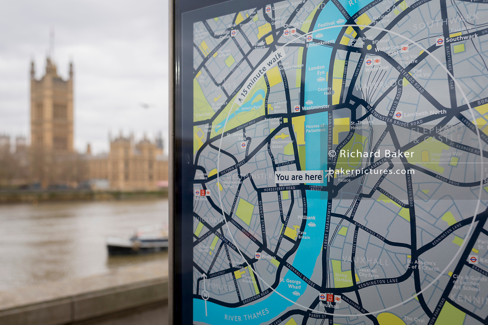 A tourism map showing the River Thames in the centre running between Southwark and Lambeth on the right and Westminster on the left bank, with the Houses of Parliament across the water, on 27th March 2019, in London, England