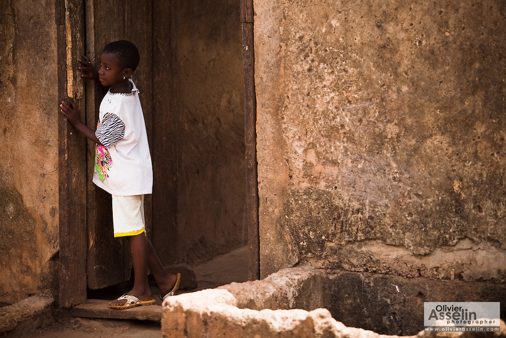 A girl looks out from the doorway of her home in the town of Salaga, northern Ghana on Thursday March 26, 2009.