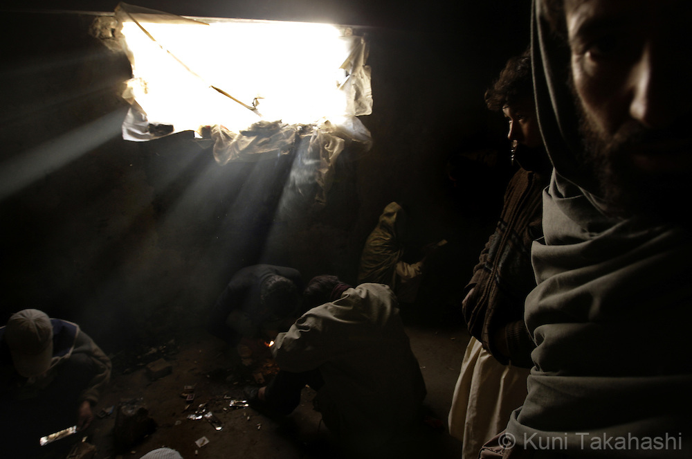 Men smoke and inject heroin in an abandoned building in Kabul, Afghanistan on Nov 14, 2008. According to the United Nations, illegal drug addiction rates in Afghanistan have doubled in the past two years. Nearly a million people are believed to be using illegal drugs, including more than 150,000 opium users and 50,000 heroin addicts...