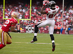 October 11, 2009; San Francisco, CA, USA;  Atlanta Falcons wide receiver Roddy White (84) catches a pass in front of San Francisco 49ers defensive back Nate Clements (22) in the first quarter at Candlestick Park. Atlanta won 45-10.