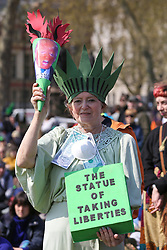© Licensed to London News Pictures. 15/04/2019. London, UK. A woman activist dressed as Statue of Liberty demonstrates in Parliament Square to demand decisive action from the UK Government on the environmental crisis by bringing central London to a standstill. Photo credit: Dinendra Haria/LNP