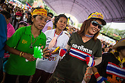 24 NOVEMBER 2012 - BANGKOK, THAILAND: Women dance during a large anti government, pro-monarchy, protest  on November 24, 2012 in Bangkok, Thailand. The Siam Pitak group, which sponsored the protest, cited alleged government corruption and anti-monarchist elements within the ruling party as grounds for the protest. Police used tear gas and baton charges againt protesters.       PHOTO BY JACK KURTZ