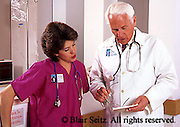 Doctor, Physician at Work, Medical Teams, Doctor Consults with Nurse