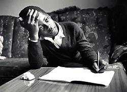 Secondary schoolboy doing his homework, Nottingham, UK 1988