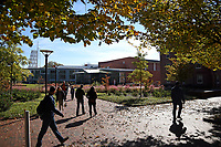 Students walks across Central Campus on a sunny fall day.