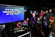 Children sing at a karaoke machine in the Sandy Hook section of Newtown during tree lighting festivities, Saturday, Dec. 2, 2017. (Jessica Hill for the New York Times)