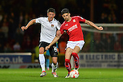 Northampton Town Forward, Alex Revell (10) and Swindon Town Defender, Raphael Rossi Branco battle for the ball during the EFL Sky Bet League 1 match between Swindon Town and Northampton Town at the County Ground, Swindon, England on 27 September 2016. Photo by Adam Rivers.
