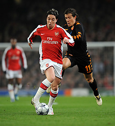Samir Nasri of Arsenal takes on Rodrigo Taddei of AS Roma during the UEFA Champions League First knockout round, First Leg match between Arsenal and A.S. Roma at Emirates Stadium on February 24, 2009 in London, England.