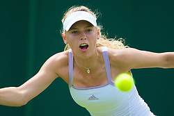LONDON, ENGLAND - Tuesday, June 24, 2008: Caroline Wozniacki (DEN) during her first round match on day two of the Wimbledon Lawn Tennis Championships at the All England Lawn Tennis and Croquet Club. (Photo by David Rawcliffe/Propaganda)