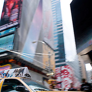A New York City Taxi passes through Times Square in New York City, NY.