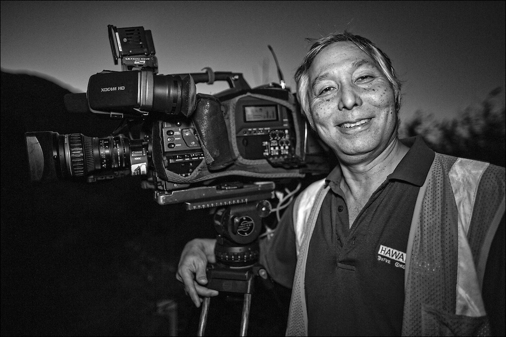 Johnny Yasunaga cameraman for KGMB/HNN Sunrise crew pauses at daybreak after doing morning live remote from Makapuu Lookout Trail. 6:24am.