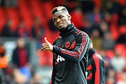 Paul Pogba (6) of Manchester United gives a thumbs up as he warms up before the Premier League match between Bournemouth and Manchester United at the Vitality Stadium, Bournemouth, England on 3 November 2018.