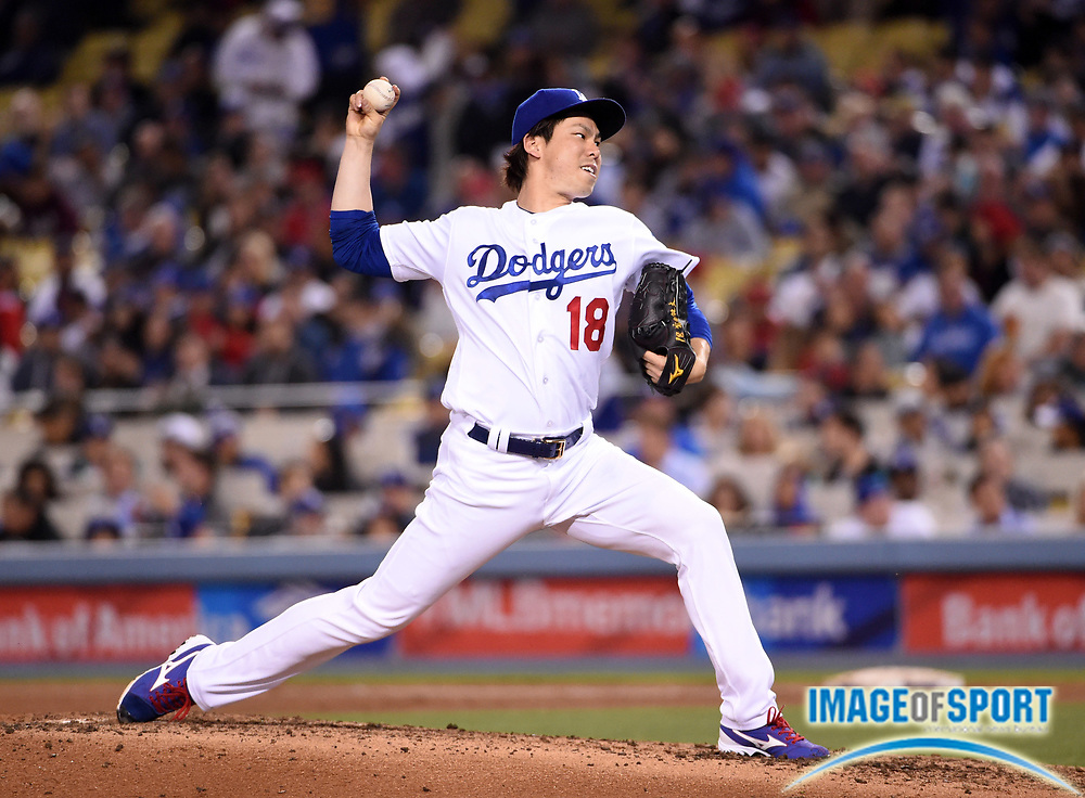 May 16, 2016; Los Angeles, CA, USA; Los Angeles Dodgers starting pitcher Kenta Maeda (18) delivers a pitch during an interleague MLB game against the Los Angeles Angels at Dodger Stadium.