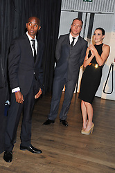 Left to right, MO FARAH, SIR CHRIS HOY and VICTORIA PENDLETON at the GQ Men of The Year Awards 2012 held at The Royal Opera House, London on 4th September 2012.