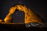 The Orion constellation shines through Delicate Arch in Arches National Park, Utah.