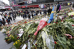 April 14, 2017 - Stockholm, Sweden - Flowers continue to be left at a makeshift memorial exactly one week after the truck terror attack in Stockholm, Sweden. (Credit Image: © Johan Jeppsson/IBL via ZUMA Press)