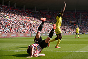 Burton Albion striker Lucas Akins (10) appeals for a decision whilst Sunderland defender Marc Wilson (36) takes a tumble during the EFL Sky Bet Championship match between Sunderland and Burton Albion at the Stadium Of Light, Sunderland, England on 21 April 2018. Picture by Richard Holmes.