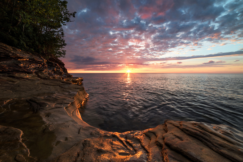 A summer sunset over Lake Superior Pictured Rocks National Lakeshore