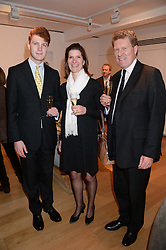Left to right, HUGO NORBURY, FIONA NORBURY and JONATHAN NORBURY at a reception to launch Prestat's special edition of their award-winning chocolate bars to raise money for the charity Walking with the Wounded held at Sladmore Gallery, Bruton Place, London on 10th October 2013.