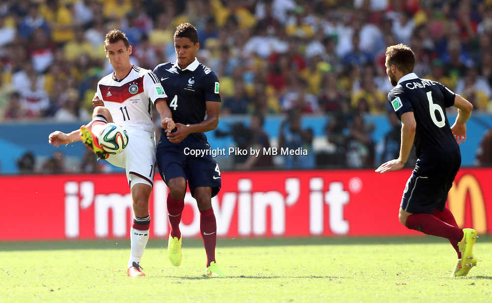 Fifa Soccer World Cup - Brazil 2014 - <br /> FRANCE (FRA) Vs. GERMANY (GER) - Quarter-finals - Estadio do Maracana Rio De Janeiro -- Brazil (BRA) - 04 July 2014 <br /> Here German player Miroslav KLOSE (L). French players Raphael VARANE (C) and Yohan CABAYE (R).<br /> &copy; PikoPress