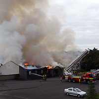 Firefighters try to put out the large fire which completely engulfed the Jeanfield Swifts Social Club on Crieff Road in Perth.<br />