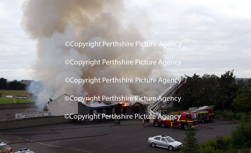Firefighters try to put out the large fire which completely engulfed the Jeanfield Swifts Social Club on Crieff Road in Perth.<br />Picture by Graeme Hart.<br />Copyright Perthshire Picture Agency<br />Tel: 01738 623350  Mobile: 07990 594431