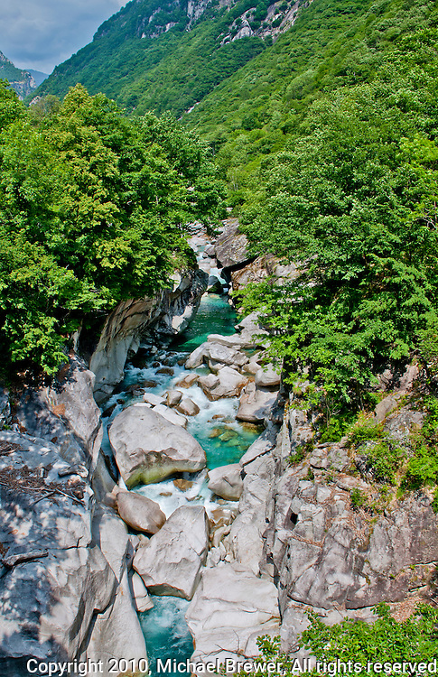 Breathtaking view down the boulder-strewn Verzasca River near Ganne in Ticino, Switzerland.  The river has carved it's way through this beautiful forested landscape.