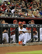 Jul. 26, 2012; Phoenix, AZ, USA; Arizona Diamondbacks outfielder Chris Young (24) reacts from the dugout during the game against the New York Mets at Chase Field. The Mets defeated the Diamondbacks 3-1.  Mandatory Credit: Jennifer Stewart-US PRESSWIRE