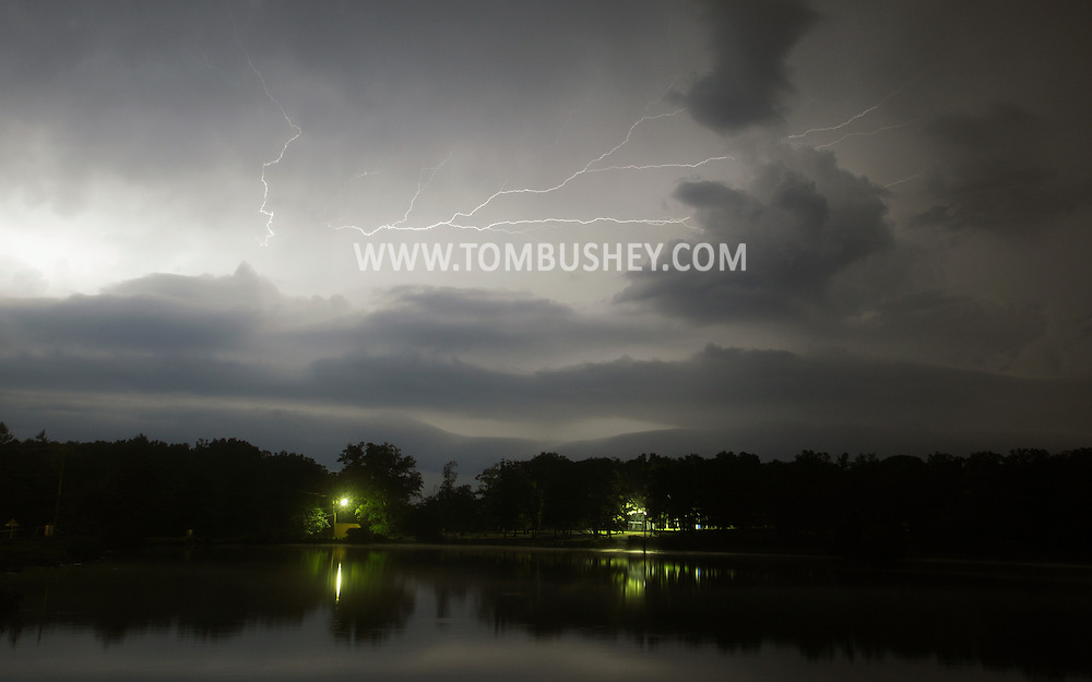 Middletown, New York - Lightning streaks across the sky above the lake at Fancher-Davidge Park during a thunderstorm on the night of Aug. 1, 2011.