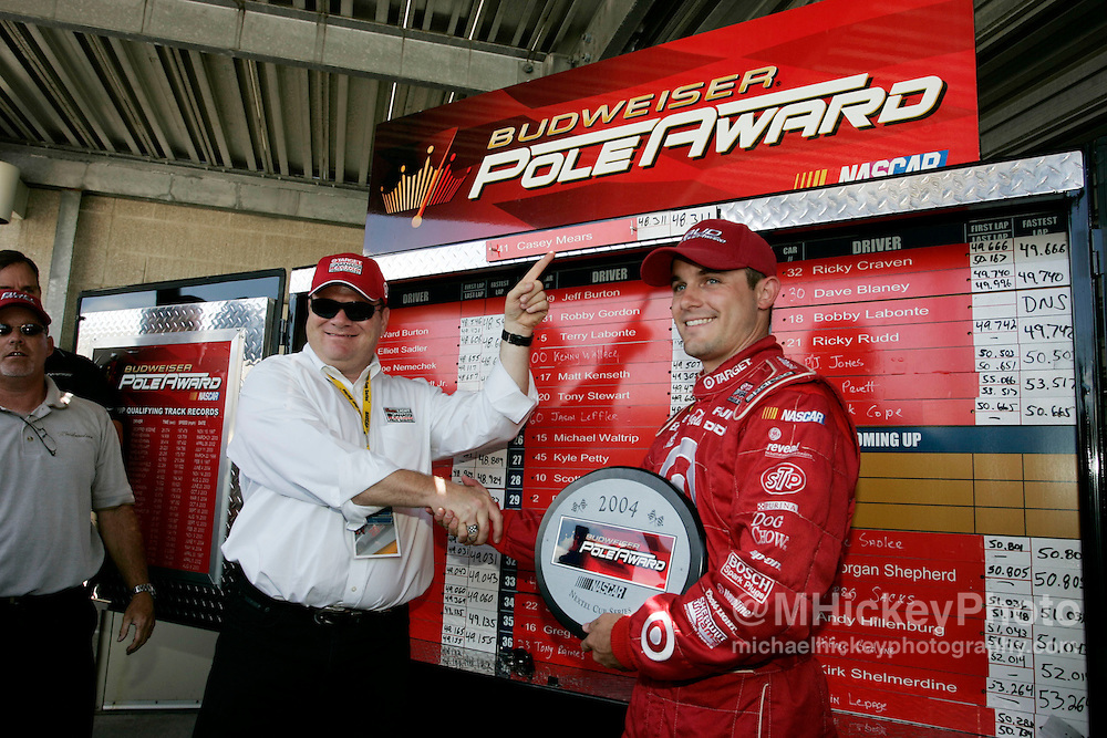 Chip Ganassi and Casey Mears pose for the Bud Pole Award after winning the Brickyard 400 pole position.