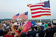 Highland, New York - People salute the flag during a Memorial Day ceremony at the center of the Walkway over the Hudson on May 27, 2012.